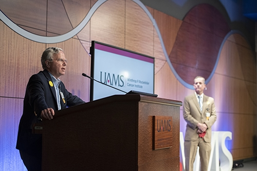 Steppe Mette, left, speaks about COVID-19 infections during the Town Hall. Chancellor Patterson listens while on stage.