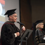 Eddie Dunn, Pharm.D., and Melanie Reinhardt, Pharm.D., announce graduates as they are hooded virtually by family and friends during the College of Pharmacy Seniors Honors & Awards Ceremony on May 14, 2021.
