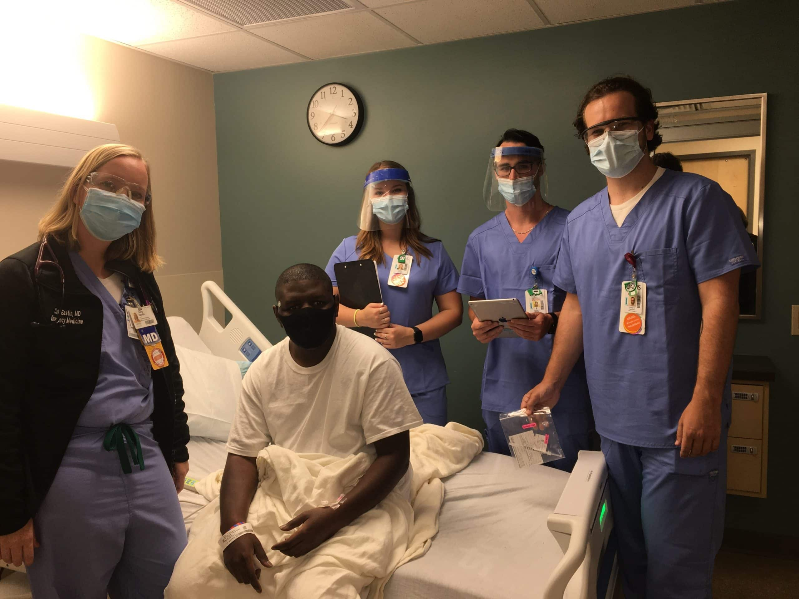 Carly Eastin, M.D., left, patient Antonio Jackson and second-year medical students Cammie York, Beau Pennington and Luke Lefler.