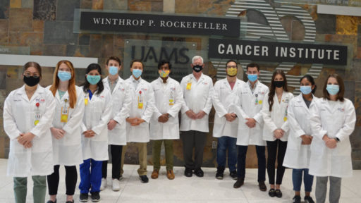 The NIH-funded Partners in Cancer Research Program is underway at the Winthrop P. Rockefeller Cancer Institute. Second-year medical students learning clinical and in-depth cancer research this summer include (l to r) Nadia Safar, Anna Bragg, Pamela Rosales, Payton Smith, Carl Ramponi, Faizan Cheema, Tom Kelly, M.D. (associate director of Cancer Research and Training), Angel Castro, Robert Kiss, Delanie Mack, Sangeetha Sonney and Claire Keisling. Matthew Newman is not pictured.