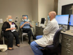 From left, Beverly Holloway, Patrick Holloway and audiologist Matthew Brown, Au. D., at Patrick's May 4 appointment.