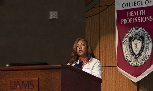 Gloria Richard-Davis introduces UAMS Chancellor Cam Patterson at the Physician Assistant White Coat Ceremony.