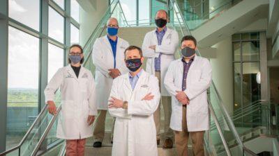 Members of the UAMS proteomics team are Alan Tackett, Ph.D. (center front), and (l-r) Stephanie Byrum, Ph.D., Rick Edmondson, Ph.D., Aaron Storey, Ph.D., and Samuel Mackintosh, Ph.D.