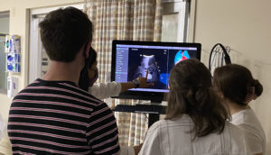 UAMS' Nayanatara Swamy, M.D., (far left) points out abdominal structures detected by ultrasound on a manikin in the UAMS Simulation Center. Medical students looking on are part of UAMS' first summer cancer research program funded by the National Institutes of Health.