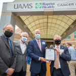 UAMS Winthrop P. Rockefeller Cancer Institute Director Michael Birrer, M.D., Ph.D., North Little Rock Mayor Terry Hartwick, Baptist Health CEO Troy Wells, and UAMS Senior Vice Chancellor and Medical Center CEO Steppe Mette, M.D., in front of the new UAMS Baptist Health Cancer Center in North Little Rock.