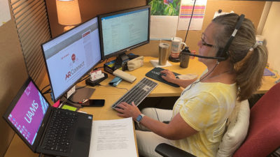 Administrative Coordinator Suzi Rook updates a schedule for AR-Connect's therapists.