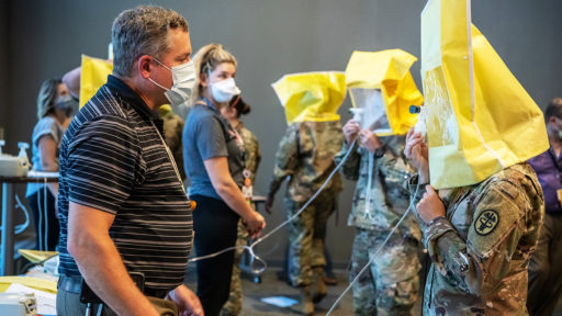 Members of an Army medical team get fit-tested for personal protective equipment. The Army arrived on campus Sept. 10 to help provide COVID-19 patient care in the UAMS Medical Center.