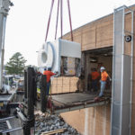 Using a crane, workers Sept. 13 install a new MRI scanner in the UAMS Psychiatric Research Institute.