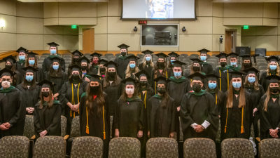 The Physician Assistant Program Class of 2021 stand Aug. 27 in Smith Auditorium for a final group photo after their Valediction ceremony.