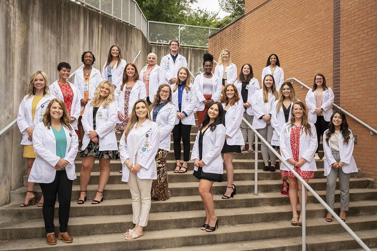 Students gather for a photo after receiving their white coats. They are members of the in the Master of Science (M.S.) in Communication Sciences in Disorders Class of 2023