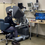 Ashley Smith, M.D., a urology resident, gets a chance to train on the da Vinci Surgical System.