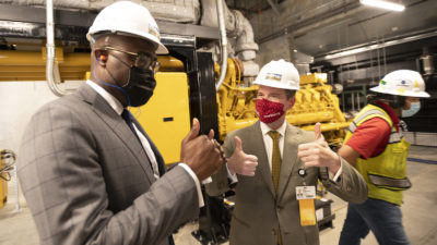 Chancellor Cam Patterson, right, shares a thumbs-up moment with Little Rock Mayor Frank Scott Jr. after the mayor turned on one of the generators in the new power plant at the conclusion of the formal opening of the facility.