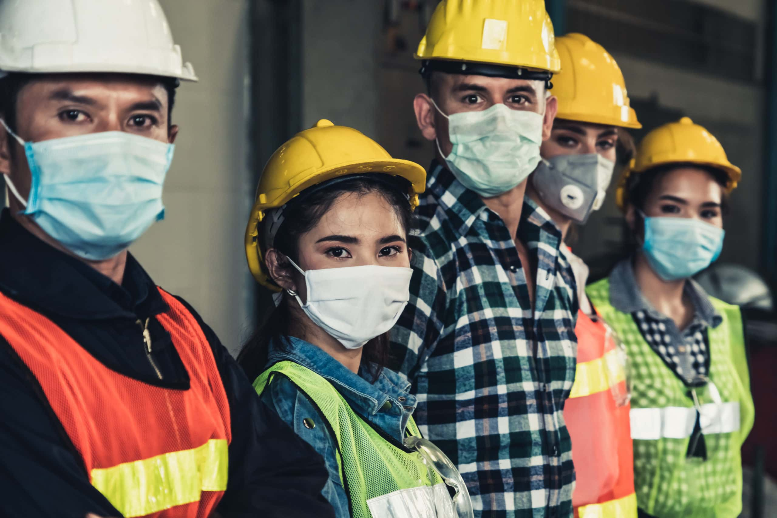 Workers with face masks
